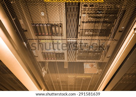 computer server in rack with gold light close up - stock photo