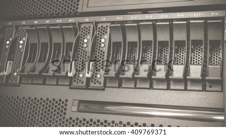 Computer Server mainframe and raid storage in datacenter , process in vintage black and white style. - stock photo