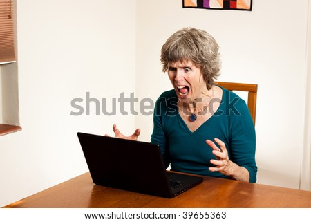 Computer stress - screaming at the computer - stock photo