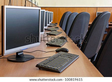computer study lab. image with selective focus on first LCD monitor. - stock photo