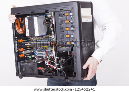 computer support engineer holding an office Computer for upgrading it. Studio shot on a white background