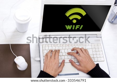 computer table with wifi signal - stock photo