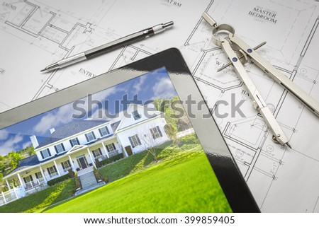 Computer Tablet Showing Finished House Sitting On House Plans With Pencil and Compass. - stock photo