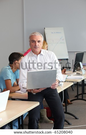 Computer teacher in classroom