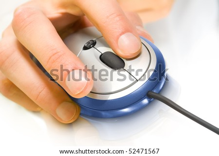 computer technology. blue mouse with hand over white background - stock photo