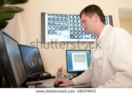 computer tomography diagnostics, doctor working with films - stock photo
