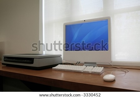 computer turned on, located next to scanner - perfect for business or school use - stock photo
