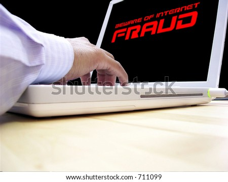 Computer user concerned about internet fraud - stock photo