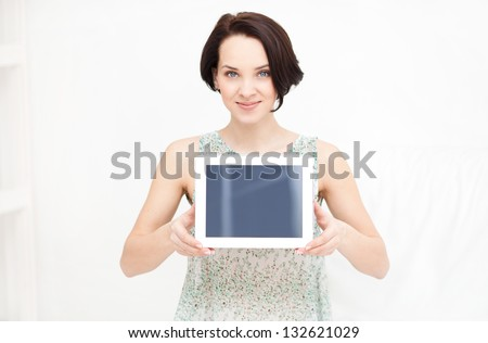 Computer.White.Brunette.Female.Business.Idea.Tablet pc. A woman holding a tablet pc   isolated over a white background - stock photo