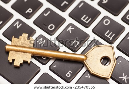 Computer with key. internet and network security concept.  - stock photo