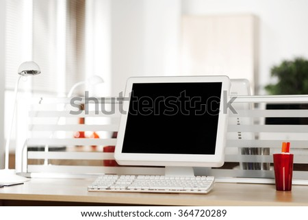 Computer with LCD screens in modern office