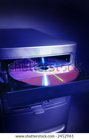 Computer with open tray with a disk - stock photo