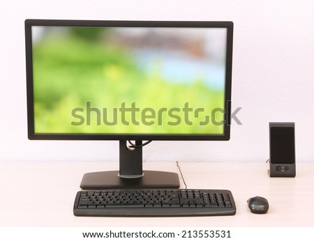 Computer with screensaver on table
