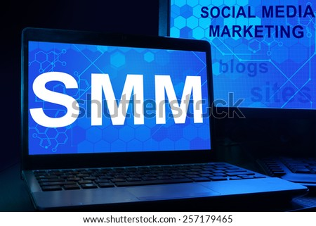 Computer with words SMM Social Media Marketing. Internet technology concept.