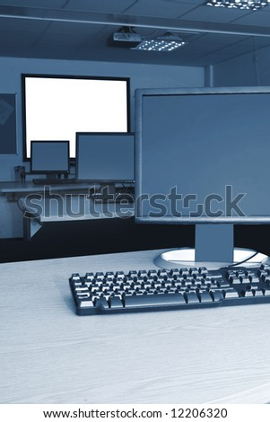 Computers and Whiteboard in training room - stock photo