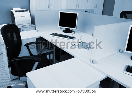 computers behind the glass in a modern office