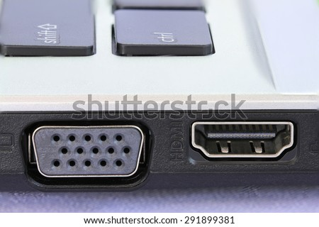 Computers digital input output port card for screen monitor or projector from handheld notebook computer. - stock photo