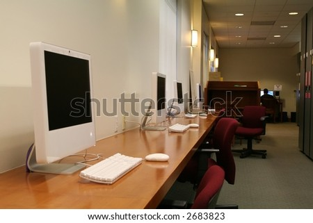 computers lined up, ready for work - stock photo