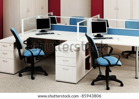 computers on the desks in a modern office - stock photo