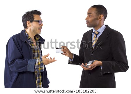 Con-artist stealing a customers credit card information - stock photo