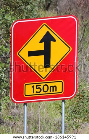 Concealed Road Warning sign 150m 1 - stock photo