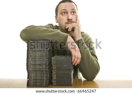 conceived man holding a collection of CDs - stock photo