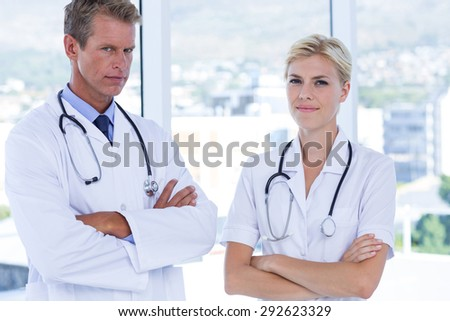 Concentrate doctors looking at camera in medical office