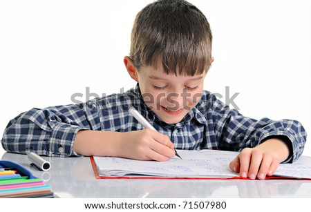concentrated and enthusiastic schoolboy doing homework isolated on white