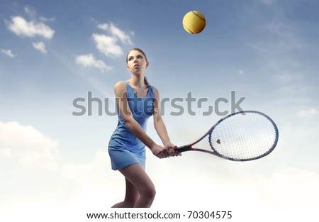 Concentrated beautiful woman playing tennis - stock photo