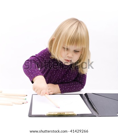 concentrated blond hair, little girl draws in open clipboard with crayons