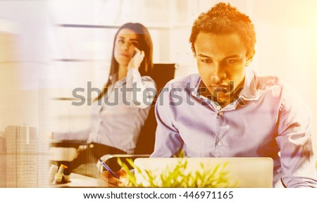 Concentrated business man and woman working on business project and having conversation on mobile phone. Concept of teamwork. Toned image - stock photo
