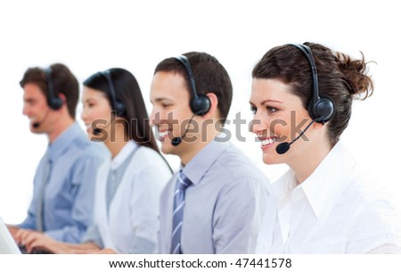 Concentrated business people talking on headset in a call center - stock photo