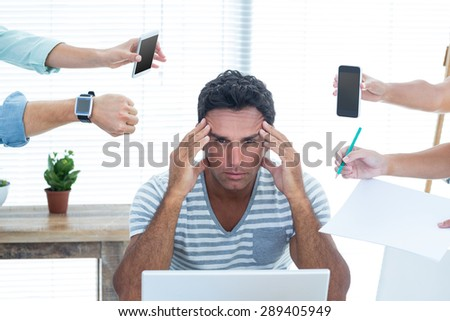 Concentrated businessman in the office - stock photo