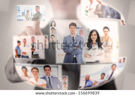 Concentrated businessman selecting a picture on digital screen - stock photo