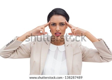 Concentrated businesswoman putting her fingers on her temples on white background