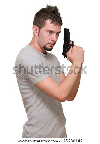 concentrated man holding gun against a white background