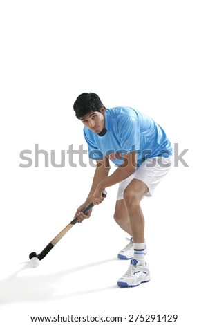 Concentrated man playing hockey isolated over white background - stock photo