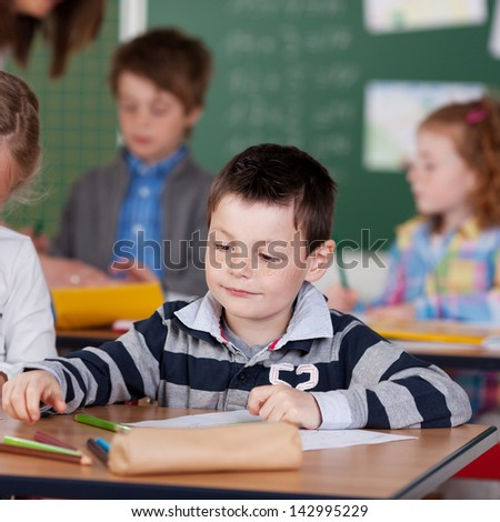 Concentrated school children being occupied in art class - stock photo