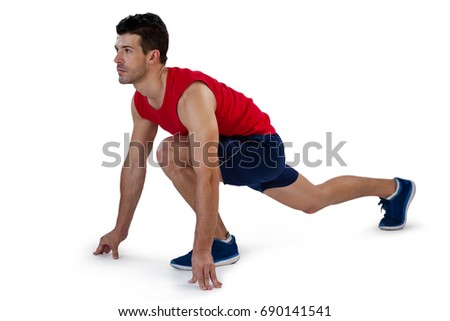 concentrated sports player running position againstの写真素材