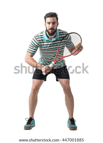 Concentrated tennis player bending and waiting for serve. Full body length portrait isolated over white studio background. - stock photo