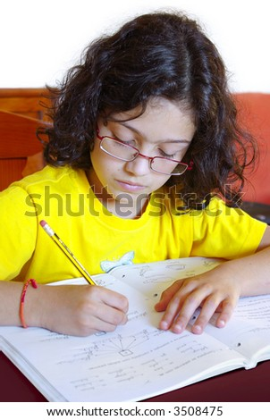 Concentrated young girl doing her school homework - stock photo