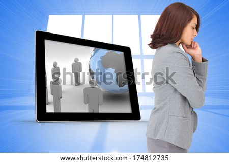 Concentrating businesswoman against bright blue room with windows - stock photo