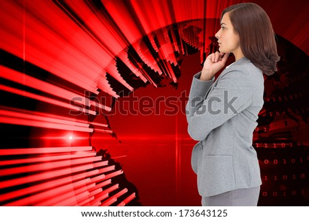 Concentrating businesswoman against stack of books against sky - stock photo