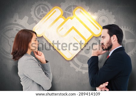 Concentrating businesswoman against white and grey background - stock photo