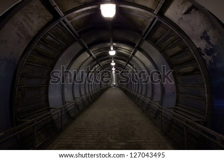 concentric dark tunnel with light - stock photo
