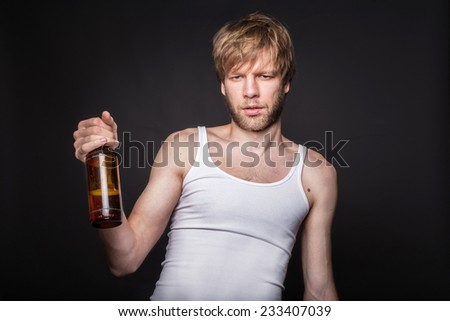 Concept: alcohol addiction. Hangover. After party. Studio portrait over black background - stock photo