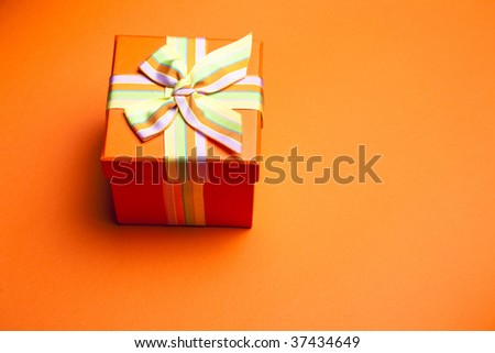 Concept and ideas: Gift Box On Orange Background