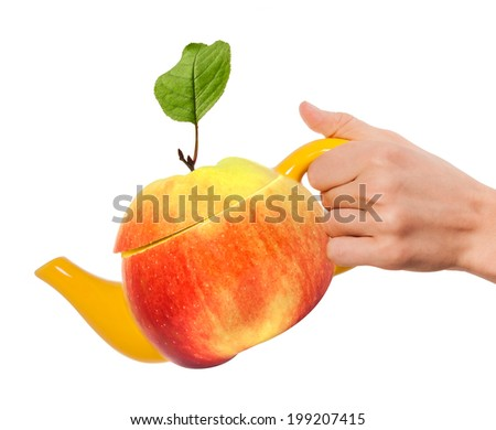 Concept apple teapot in hand - stock photo