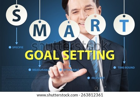 Concept. Businessman pointing goal setting for smart concept - stock photo