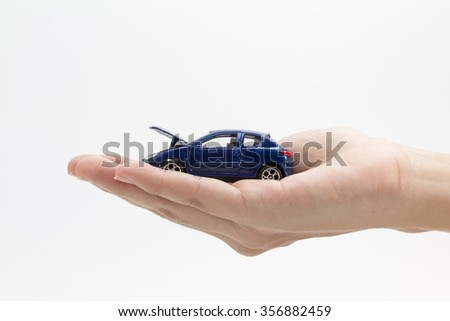 """concept : """"car insurance"""" blue car accident in hand - stock photo"""
